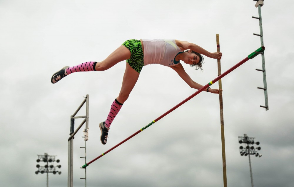 Katrina Rodriguez, a track and field alumna, pole vaults at the alumni meet.Photo credit: Emily Teague