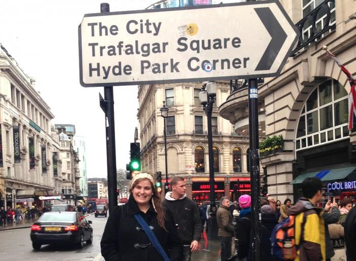 Writer Michelle Manera travels to London for the first time and poses for a picture at Piccadilly Circus.