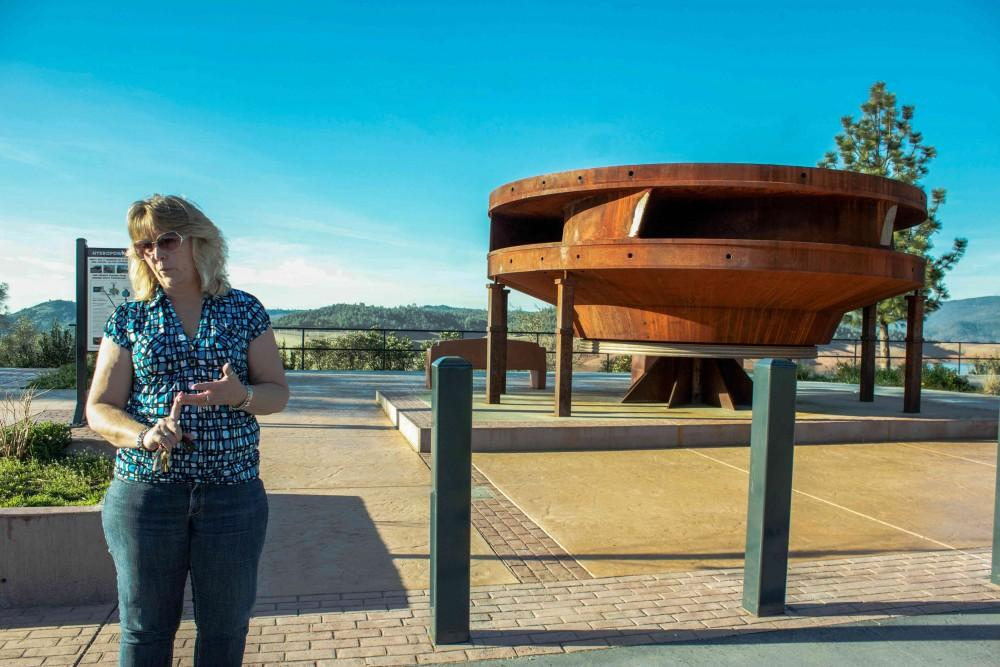 Jana Frazier, an Oroville Dam tour guide, explains how the hydroelectric turbines work.Photo credit: Chelsea Jeffers