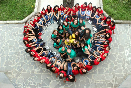 A camp for girls in Armenia led by the Peace Corps form a heart in 2012. Photo courtesy of the Peace Corps.