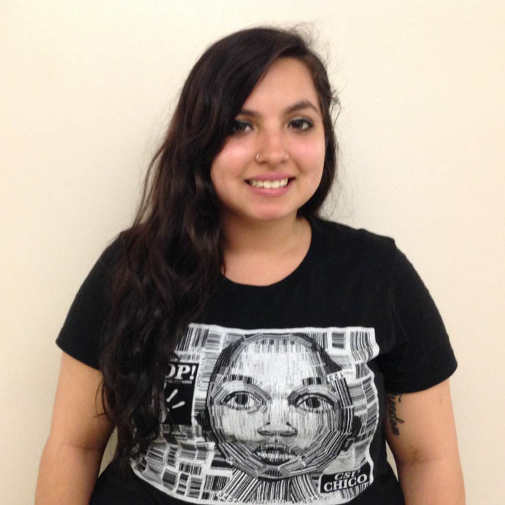 Ashlley Martinez, a junior communication sciences and disorders major and president of Stop Trafficking of Persons, sports her STOP club shirt.Photo credit: Dominique Diaz