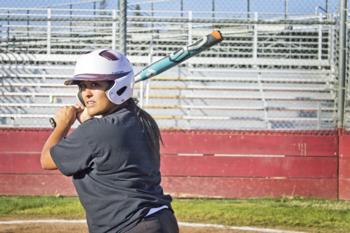 Alex Molina, senior pitcher, gets ready to bat during practice. Photo credit: Maisee Lee