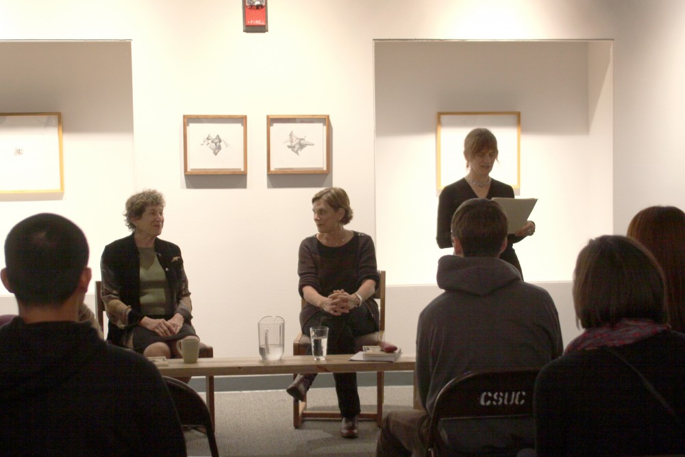Sarah Pike, director, introducing the two guest speakers Meryl Natchez and Kate Transchel at the Wednesday night reading in Trinity Hall. Photo credit: Maisee Lee