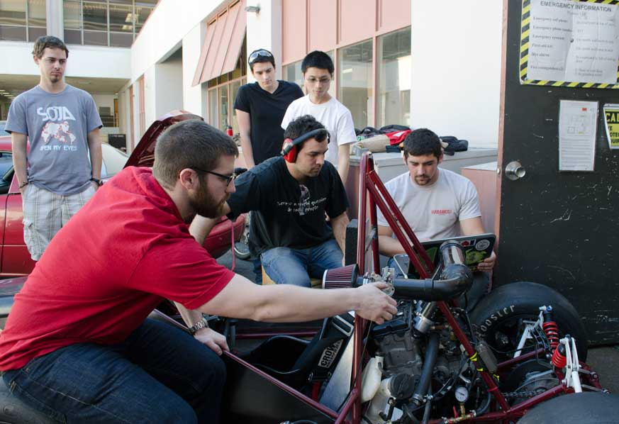Members of the Formula Society of Automotive Engineers at Chico State run tests on the vehicle so that it can idle consistently. Photo credit: Nicholas Carr