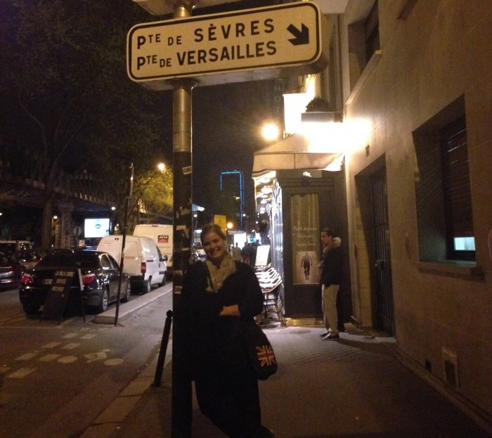 Michelle Manera poses next to a street sign in Paris. Photo courtesy of Michelle Manera.