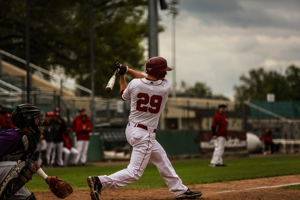 Clark prepares to throw his bat and run for first base. Photo credit: Emily Teague