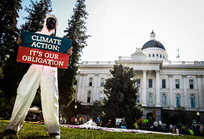 Chico State student Kevin Killion, of AS Sustainability, joins thousands of environmental activists in protesting in front of the state Capitol. Photo credit: Emily Teague