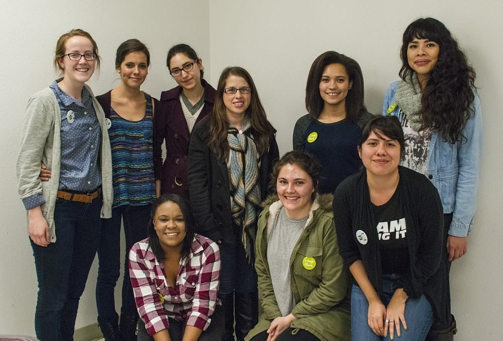 The Active Minds club sporting pins to promote mental health awareness. Photo credit: Alex Boesch