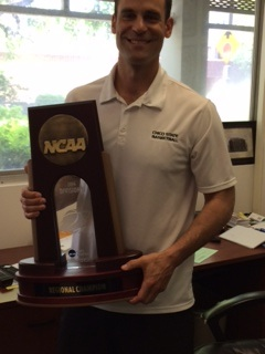 Head Coach Greg Clink holds the NCAA West Regional Trophy. Photo credit: Angelo Boscacci