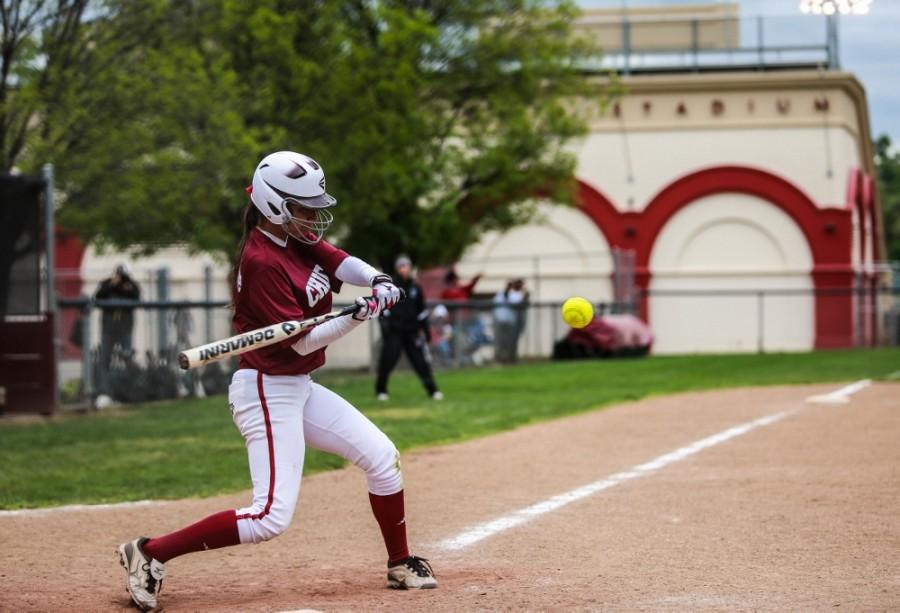 Sophomore Amanda Cordeiro swings for a hit earlier this season. Photo credit: Emily Teague