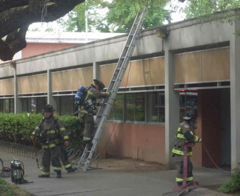 Firefighters used a portable ladder to get up and down from the roof of Acker Gym, where the mechanical fire took place. Photo credit: Angelo Boscacci