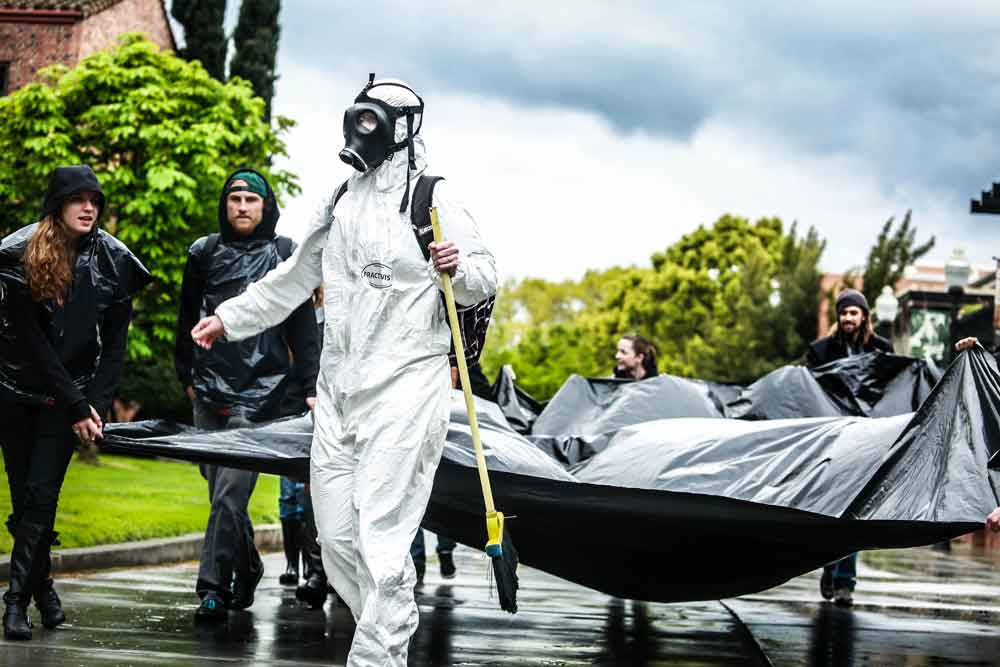 Students create 'human oil spill'