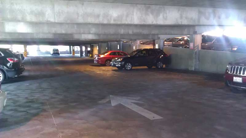 The south side of of the parking structure at 8:30 a.m. April 28 on Second and Ivy streets. In a two-week survey of vacant R-2 parking spaces, this area was consecutively empty. Photo credit: Enrique Raymundo