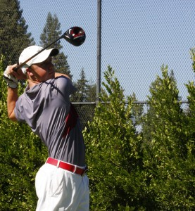 Alistair Docherty pounds a shot on the opening hole at Butte Creek Country Club last season. Orion file photo.
