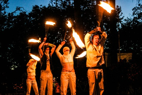 Members of the Lumininjas harmoniously performing their fire twirling routine at the Art at the Matador event Saturday, hosted by Chico Visual Arts Alliance. Photo credit: Chelsea Jeffers