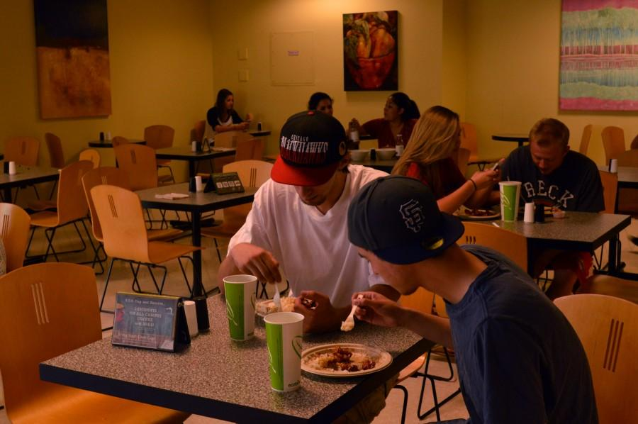 Junior Marshall Bars and freshman Bear Braud, both business management majors, enjoy lunch in the BMU Marketplace. Photo credit: Veronica Hodur