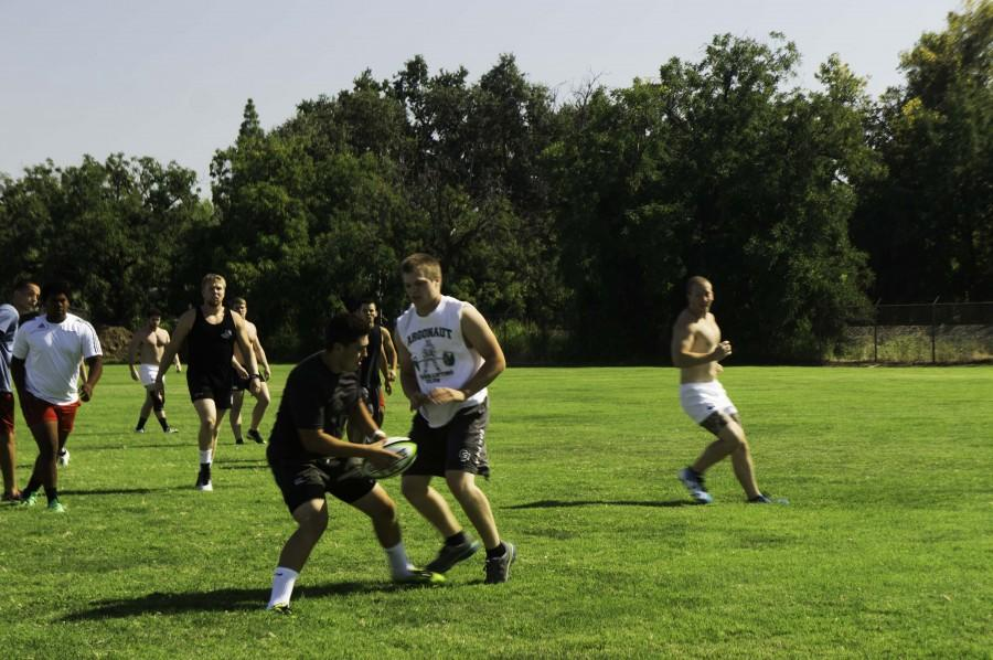 The rugby team skirmishing during its preseason. Photo credit: Brandon Foster