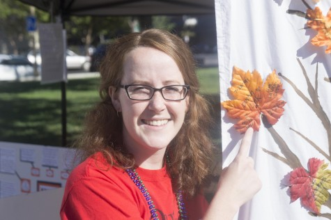 Ariel Ellis, psychology graduate student, commemorates her friends at the remembrance tree. Photo credit: Brandon Foster