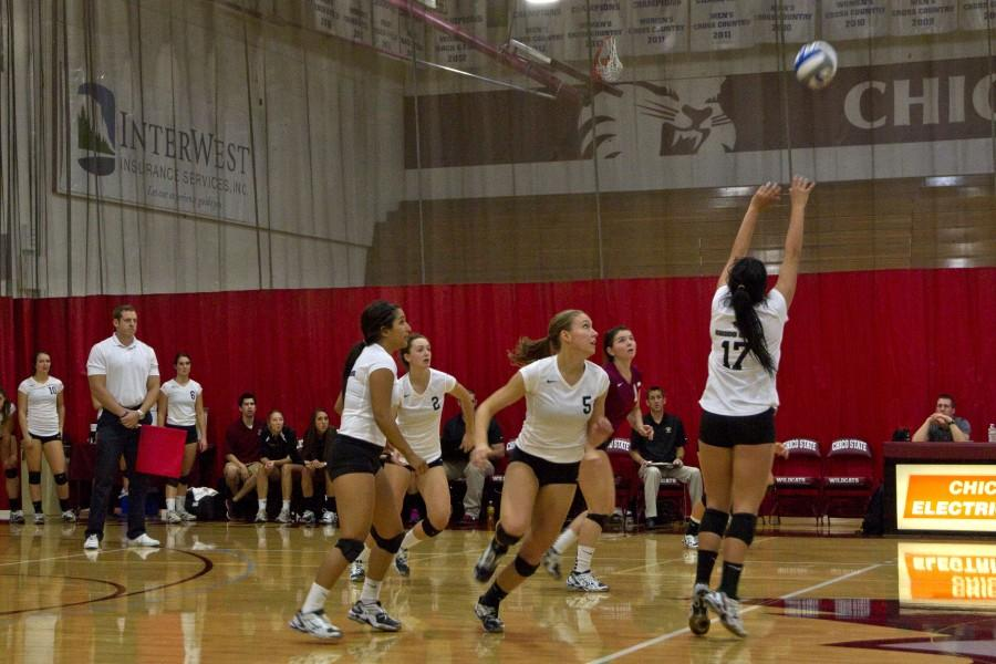 Lindsay Quigley, second from right, sets up for a return in a set earlier last season. Orion file photo.