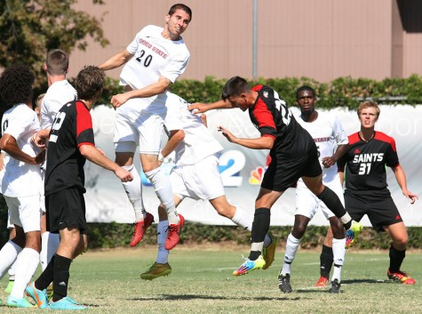 Chico State men's soccer player Mike Janjigian (20) elevates for a ball during Sunday's match against Saint Martin's University. Photo credit: John Domogma