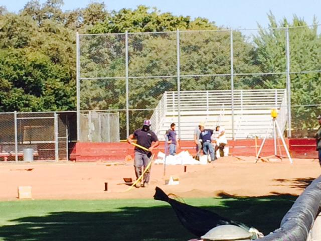 Construction workers make improvements to the Chico State softball field. Photo credit Angelo Boscacci.