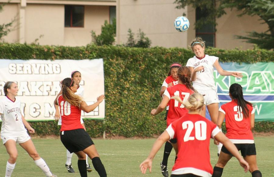 Wildcat Midfielder Lindsey Dias towers over CSU East Bay to win the header at Chico State Friday October 17, 2014. Photo credit: John Domogma