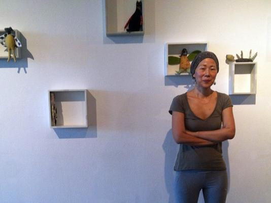 Eunkang Koh stands in front of her