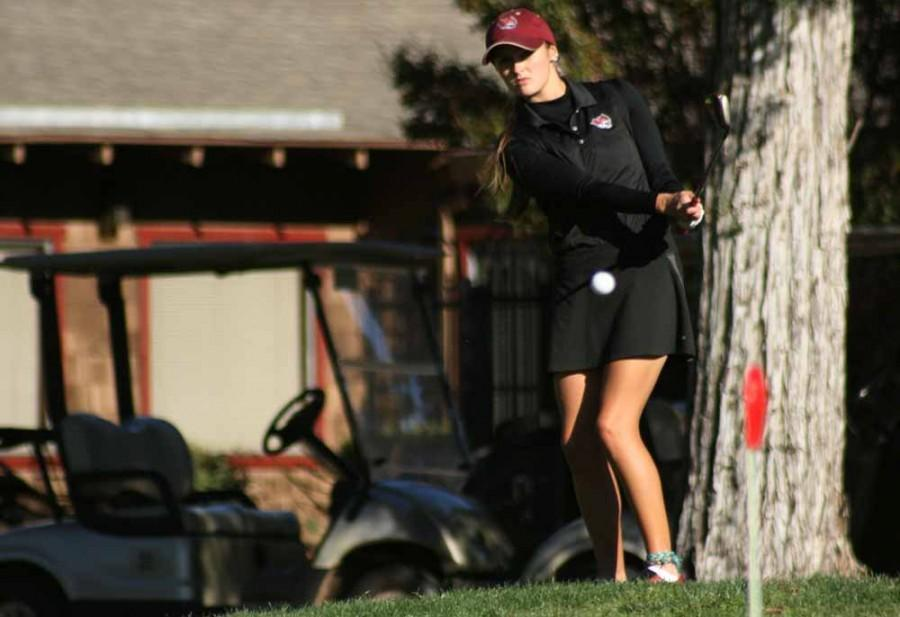 Junior Wildcat Women's Golfer Dani O'Keefe chips the ball during practice at Bidwell Golf Course MOnday October 27, 2014. Photo credit: John Domogma
