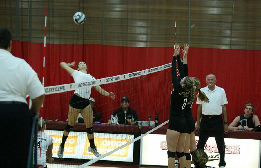 Shanon Boling of the Chico WIldcat Women's Volleyball team goes for the shot over Cal State Dominguez Hill's defense Friday, October 3, 2014 Photo credit: John Domogma