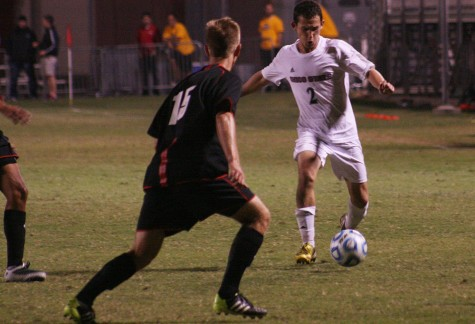 Wildcat Defender Kenny Rosecrance attempts to center the ball in the box at Chico State Friday October 17, 2014 against CSU East Bay Pioneers. Photo credit: John Domogma