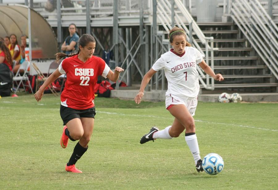 Senior forward Stephanie Vaquerano easily wins the ball over CSU East Bay Pioneer Defender Laura McIntosh Friday October 17, 2014. Photo credit: John Domogma