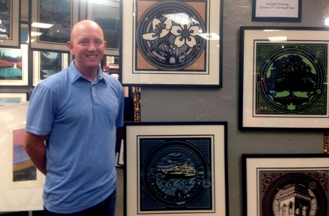 Chico State alumnus Jake Early stands next to some of the prints he created for his 'My Hometown