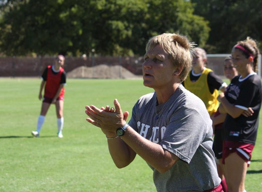 Kim Sutton encourages players during a practice last season. Orion file photo.