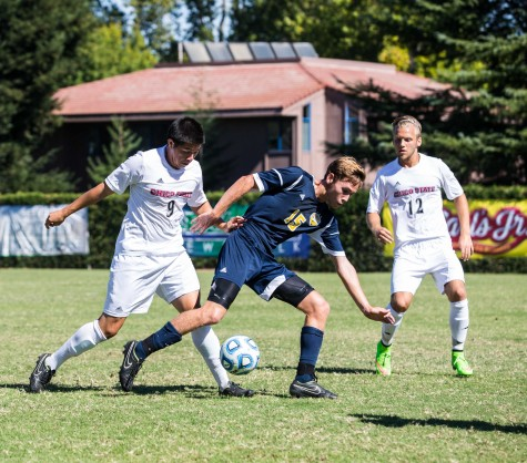 Octavio Murillo and Carter Johnson try to pry the ball away from an opposing player. Photo credit: Emily Teague