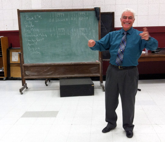 Royce Tevis, the director of bands at Chico State, waves his baton in a classroom at the Performing Arts Center. The Chico State Wind Ensemble is preparing for the 15th annual Daniel Hiestand Memorial Concert 7:30 p.m. Saturday. Photo credit: Emma Wood-Wright
