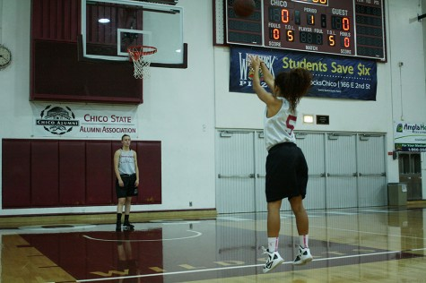 Hannah Womack lets a free throw fly in practice early in the season. Photo credit: John Domogma