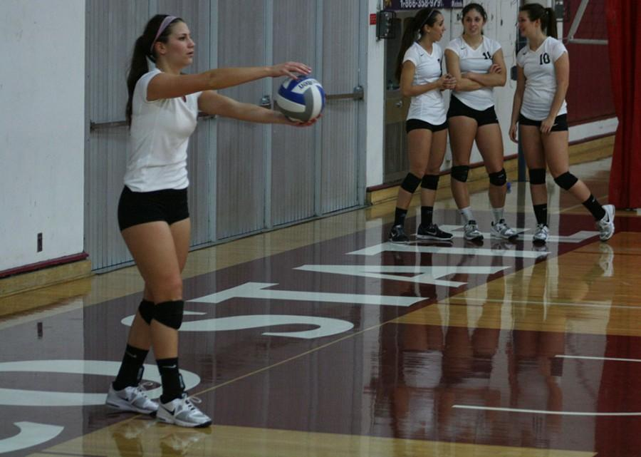 WIldcat Senior Kristyn Casalino sets up for a successful serve at Acker Gymnasium on Friday October 31, 2014. Photo credit: John Domogma