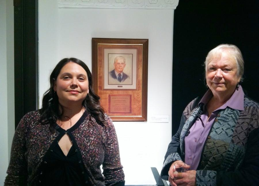 Ayres' daughter, Jean Ayres-Clark (right), and granddaughter Cara enjoy the University Art Gallery exhibit celebrating Ayres' life and artwork on Nov. 13. Photo credit: Emma Wood-Wright