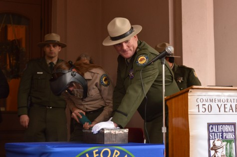 Kirk Coon, supervising ranger, smiles in anticipation before opening the long-lost time capsule left behind at the Bidwell Mansion. Photo credit: Veronica Hodur