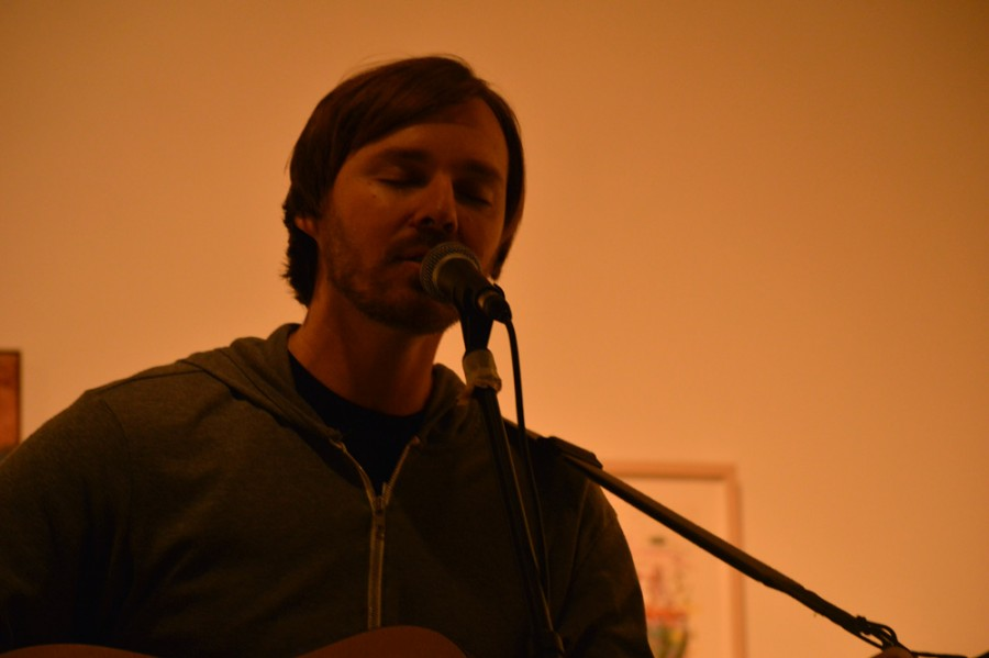 Local singer-songwriter Nolan Ford strums and sings a cover of