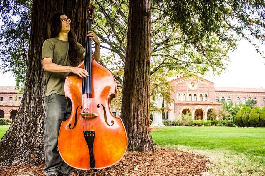 Chico State senior recording arts major Alex Montes de Oca started playing the upright bass about three years ago, though he started on a five-string electric in high school. Photo credit: Chelsea Jeffers