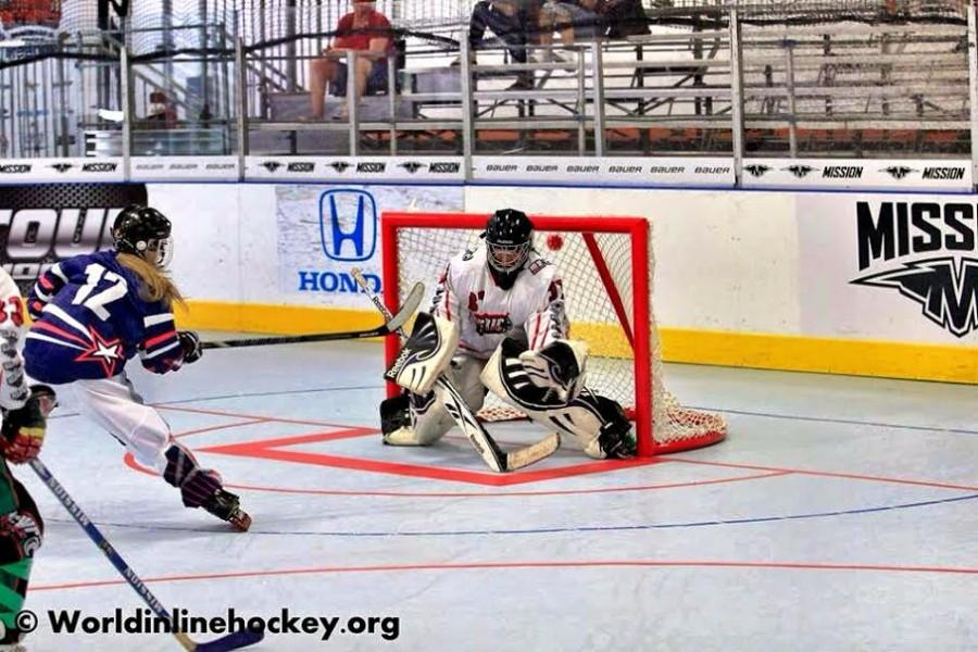 Carly Marquiss scores a goal against Mexico in the 2013 Women's Inline Hockey World Junior Championships in Huntington Beach. Photo courtesy of Carly Marquiss.