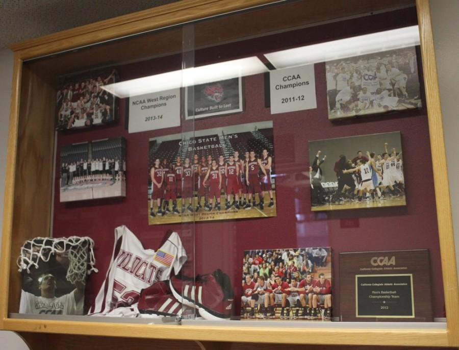 A display case in front of the Chico State men's basketball team's office inside Acker Gym highlights awards and memorabilia. Photo credit: John Domogma