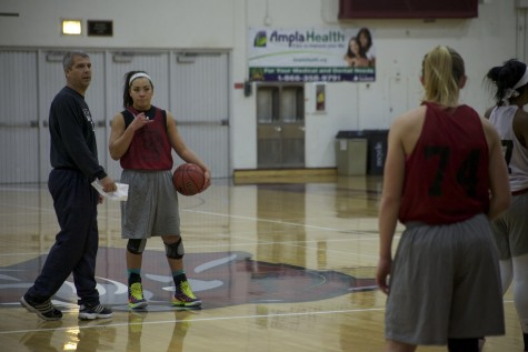 Chico State women's head coach, Brian Fogel, and freshman guard, Whitney Branham, go over plays during practice. Photo credit: John Domogma