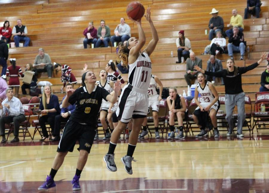 Chico State's Hannah Womack taking a shot from San Fransisco State's guard Jasmine Flanagan. Photo credit: Catalina Friz