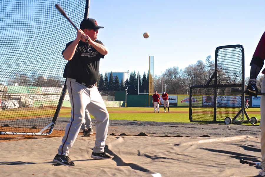 Dave Taylor keeps the team on its toes with fly balls and grounders during practice on Friday. The Wildcat baseball team is looking to make it to the Division II College World Series for the second year in a row. Photo credit: Zach Aucella