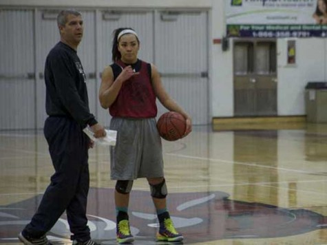 Chico State women's head coach Brian Fogel and first-year guard Whitney Branham strategize during practice. Branham has started in all games this season and is tied for the most assists. Photo credit: John Domogma