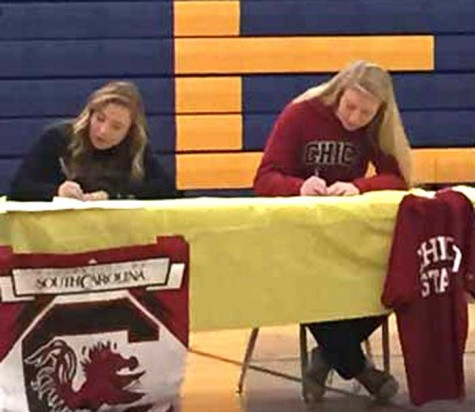 Sammy DeHart, right, signs her National Letter of Intent to attend Chico State in the fall. DeHart started for two years on Nevada Union High School's varsity team in Grass Valley and was one of two team captains. Photo courtesy of Rory Miller.