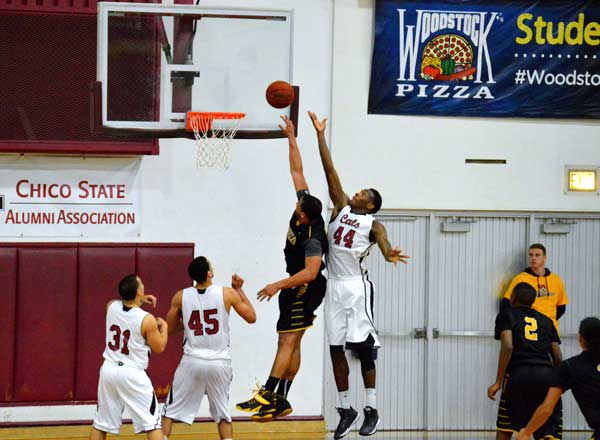 Chico State's Isaiah Ellis jumps for a rebound against Cal State L.A.'s Andre McPhail on Friday. Ellis is averaging six points per game but recently tied his season high of 14 points against Cal State East Bay on Jan. 23. Photo credit: Caio Calado