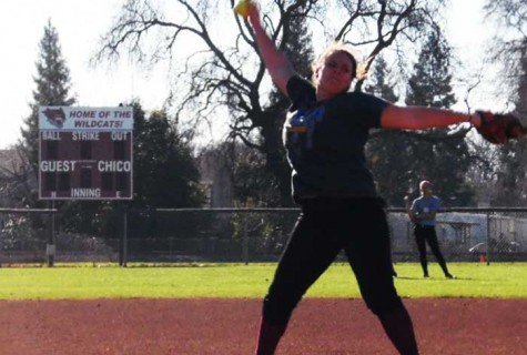 First year pitcher Haley Gilham winds up for a pitch during practice. Photo credit: George Johnston